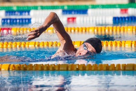 swimmer with waterproof hearing aids
