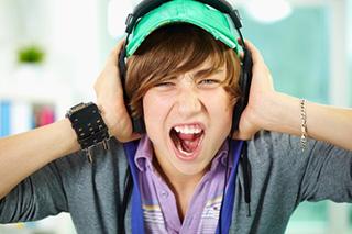 teenager damaging ears with loud music